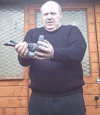 Terence McCrudden holding the champion Oisin